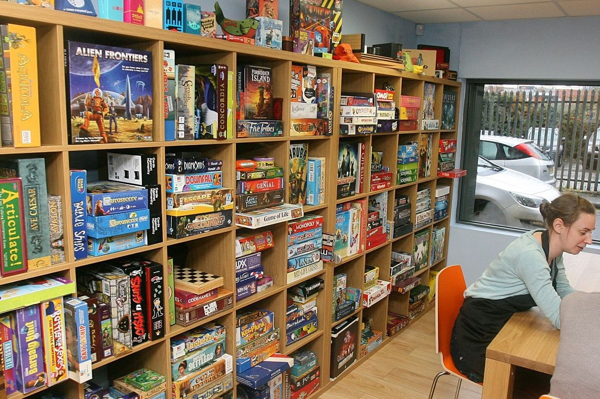 shelves-full-of-board-games-in-sugar-and-dice-board-game-cafe