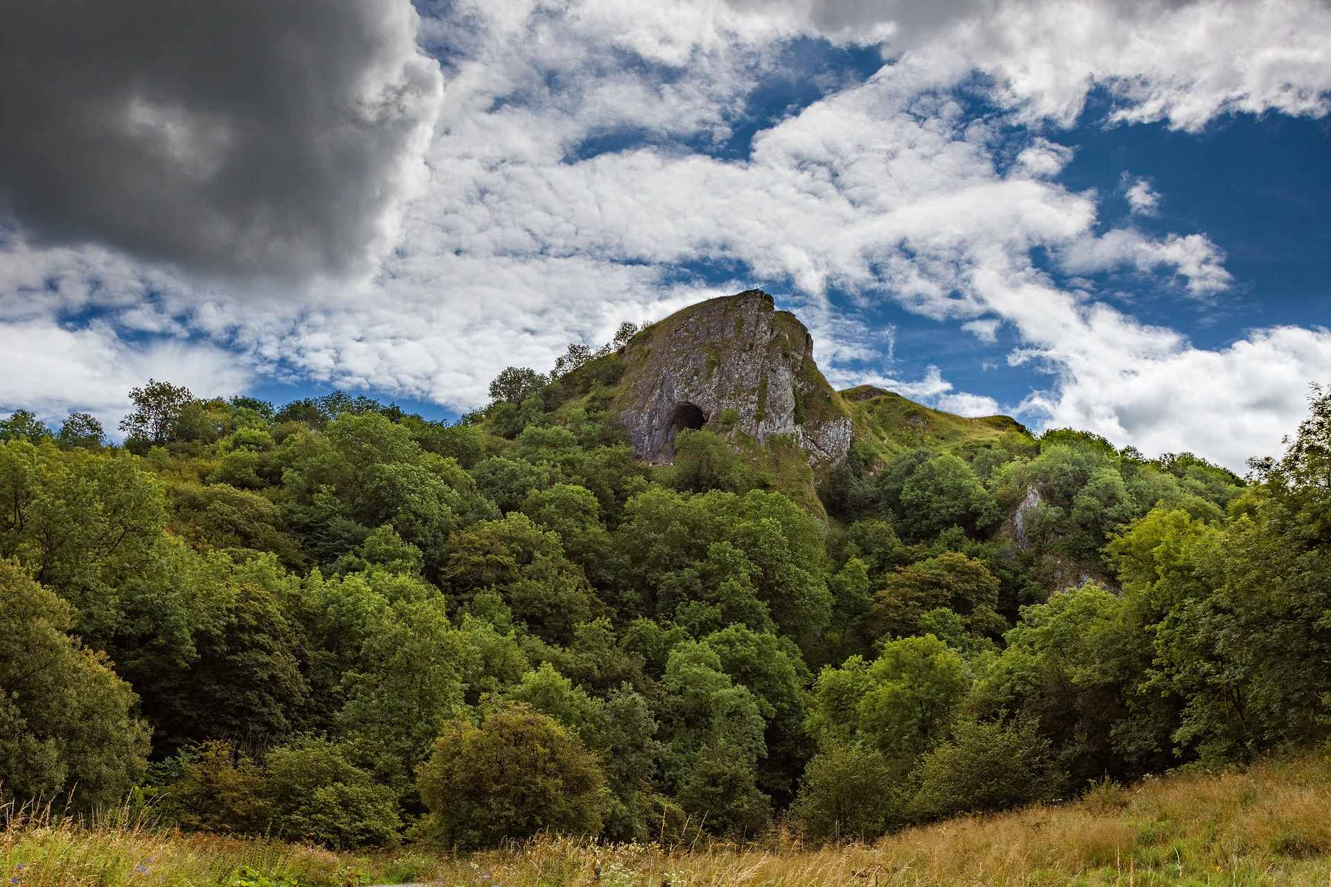 thors-cave-at-top-of-green-hill-on-cloudy-day