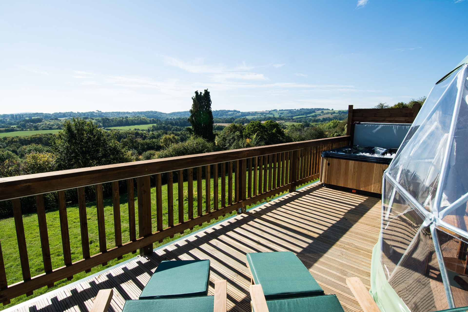 view-of-countryside-from-decking-with-geodome-sunloungers-and-hot-tub-at-redhill-holidays