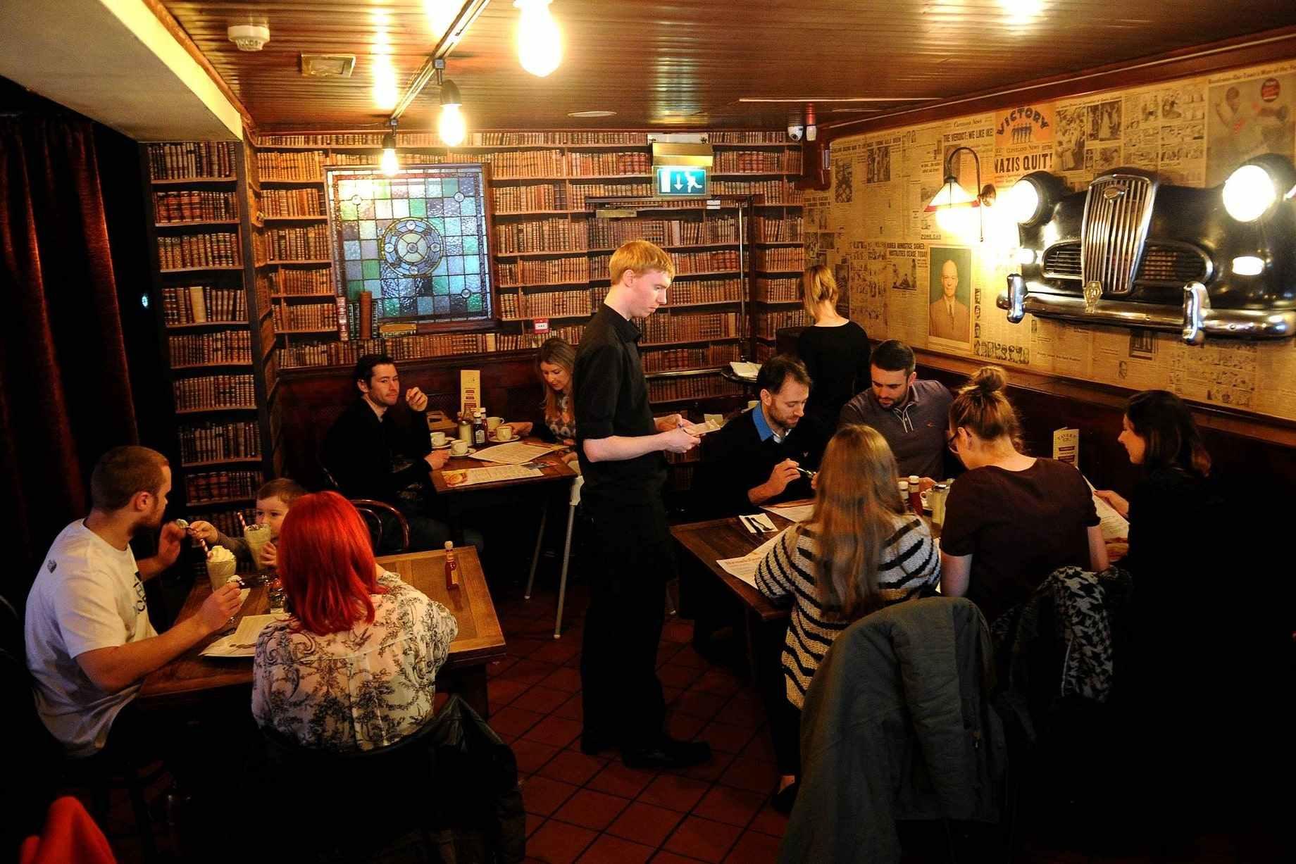 waiter-taking-order-at-restaurant-table-at-the-tavern