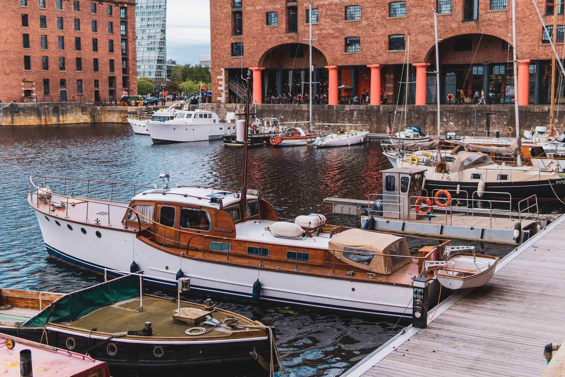 white-and-brown-boat-on-boatyard-at-liverpool-docks