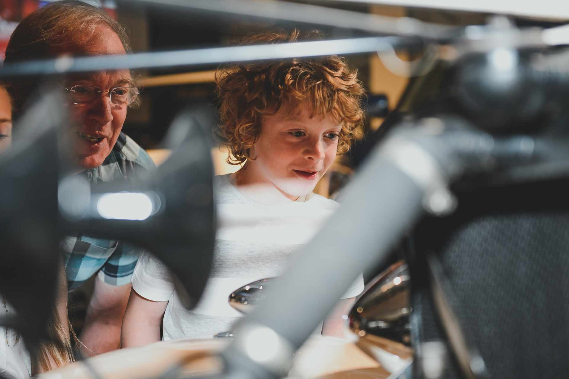 young-boy-and-granddad-looking-at-machinery-in-beaulieu-national-motor-museum